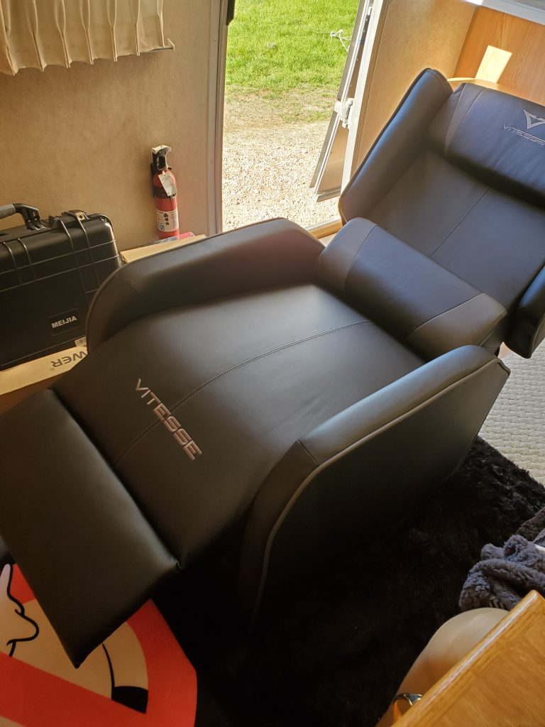 The faux leather VITESSE Gaming Recliner Chair fits perfectly into the space of my Airstream trailer's living room and is very comfortable to recline in. I spend several hours a day working on my laptop while sitting in it .