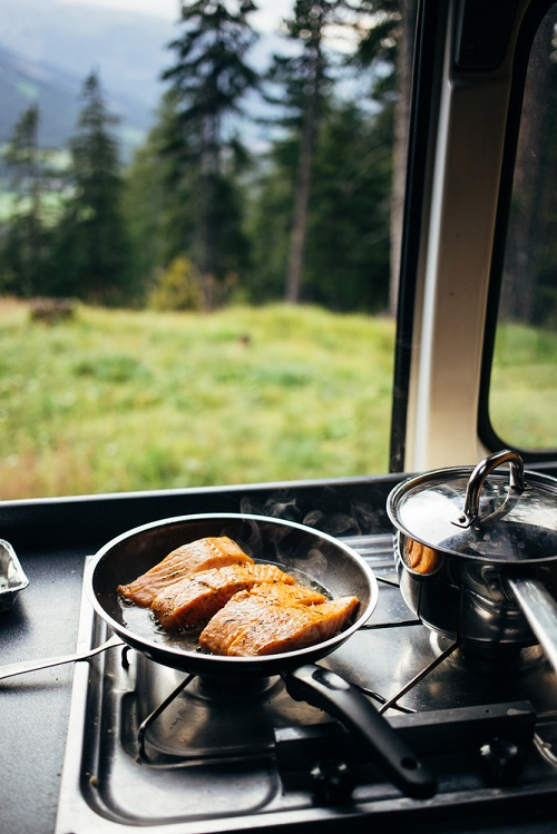 A camp stove will make cooking inside your camper van much easier and help keep your food budget manageable.