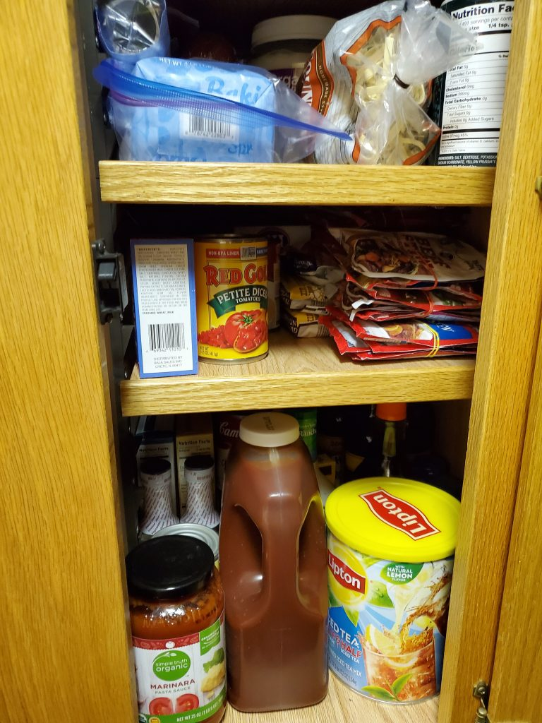 Rubber bands tie several packages of gravy and sauce mix together., allowing for more cabinet space.